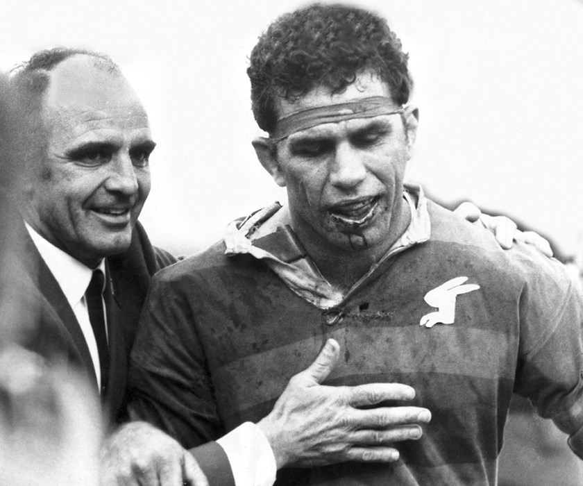 A legendary moment captured in time - Rabbitohs captain John Sattler, who played with a broken jaw for 77 minutes in the 1970 Grand Final is congratulated by his coach and Immortal Clive Churchill after the 23-12 victory over Manly-Warringah.