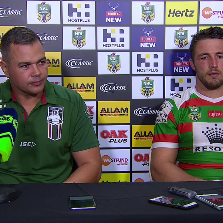 Seibold and Burgess address the press