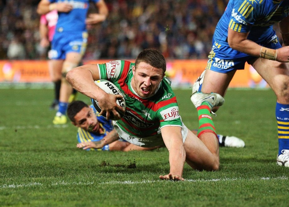 Digital Image by Robb Cox ©nrlphotos.com: Sam Burgess about to score a try :NRL Rugby League - Round 19, Parramatta Eels V South Sydney Rabbitohs at Parramatta Stadium, Friday July 18th 2014.